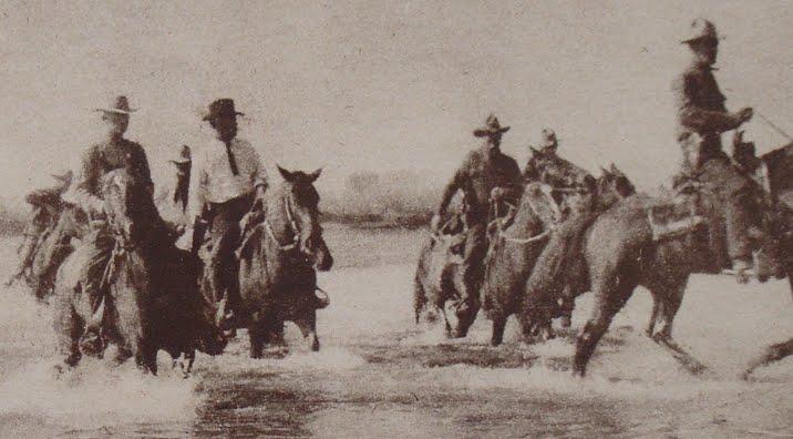 Hamer (black hat and tie) on the Rio Grande