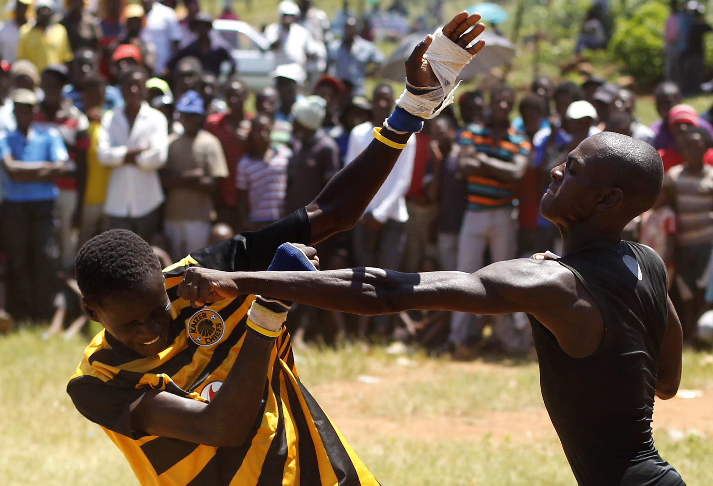 Fist fighters battle during the Musangwe, an age old tradition where man  and boys display