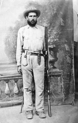 J.B. Townsend, armed with knife, revolver and shotgun.