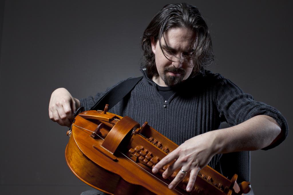 Bear McCreary plays the hurdy-gurdy.